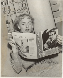 Christine Jorgensen Reading a Magazine and Smoking