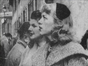 Roberta Cowell Standing in Crowd