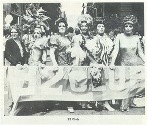 Group Holding an 82 Club Banner