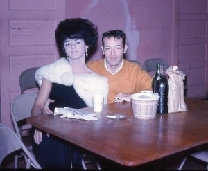 Drag Queen and Man Sitting at a Table (December 1964)