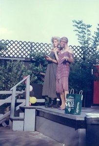 Crystal Rae Lee Love and an Unidentified Person Speak at the 1997 Christmas in July Carnival