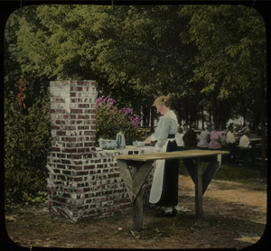 Camp fireplace, Topeka (woman cooking on brick stove)