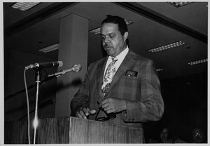 Randolph Bromery standing at podium