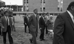 Ceremonial groundbreaking for the Conte Center: Gov. William Weld walking to the site of groundbreaking, Corinne Conte in background