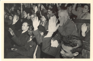 Audience members raising their hands at unidentified conference in Moscow