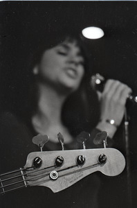 Linda Ronstadt at Paul's Mall: Fender Precision bass headstock in foreground