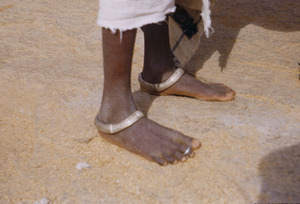 Ankle bracelets worn on a young Munda woman's feet