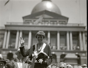 Amelia Earhart reception: Earhart waving to the crowd in front of the Massachusetts state capitol