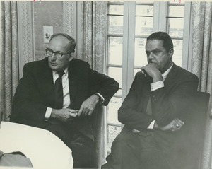 Randolph W. Bromery sitting indoors with President Robert C. Wood