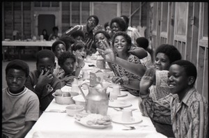 Inner City Round Table of Youth campers:group of African American kids at dining table, one wearing a Spirit in Flesh t-shirt