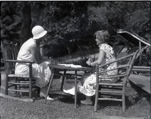 Dorothy Canfield Fisher: Fisher and unidentified woman, seated at a table outdoors