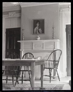 Dorothy Canfield Fisher: interior of home, showing table with Windsor charis, fireplace, and painted portrait of Fisher