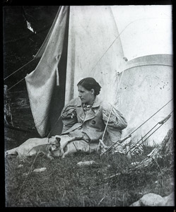 Elinor Frost and dog, seated in from of a tent
