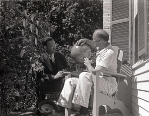 Richard Hallet: Hallet and unidentified man seated on a porch, looking at a globe