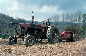 Tilling the land with Bill Stone on tractor