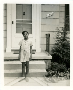 Du Bois Williams in front of Baltimore home