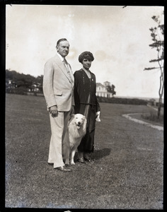 Calvin and Grace Coolidge with their white collie