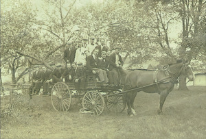 Class of 1910 students with a horse-drawn carriage