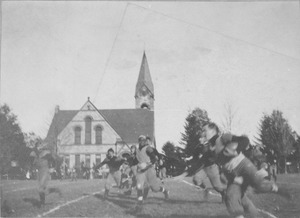 George R. Cobb running with football