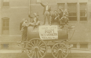 Class of 1909 members on a barrel wagon