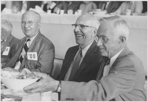 Class of 1908 alumni chatting at a reunion banquet