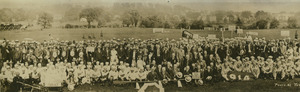 Alumnae gathered near field during 1921 commencement activities