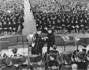 Hugh Potter Baker conferring a degree to a student
