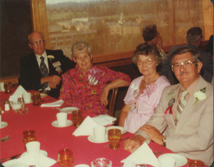 Charles Clagg and Earl Williams with their wives at reunion dinner