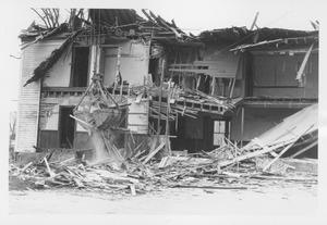 Wreckage of the Mathematics Building with bucket in operation