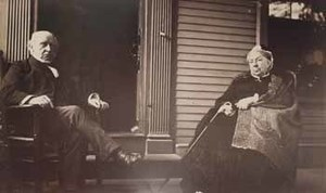 Charles F. Adams and Abigail Brooks Adams on piazza at Old House in Quincy