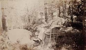 Francis Parkman seated in wicker chair, facing left