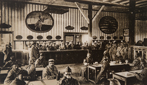Interior view of a canteen showing soldiers and Red Cross workers