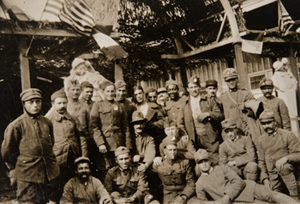 Large group of soldiers standing outside a canteen