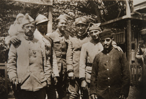 Mixed group of soldiers posed for a photograph