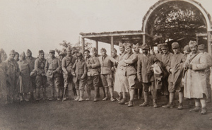 Group of soldiers posing for a photo outside a canteen