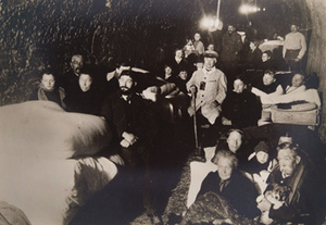 Group of civilians in an underground shelter (wine cellar)