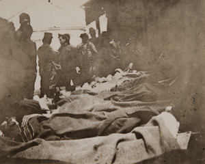Wounded soldiers on stretchers on a train platform