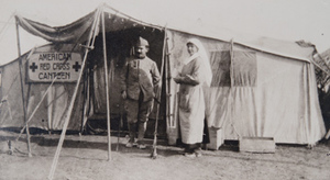 Margaret Hall and a soldier standing outside an American Red Cross canteen tent