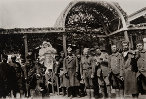 Group of soldiers pose for a photo in front of a canteen entrance