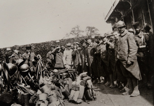Group of soldiers with their kits, pose for a photo outside a canteen