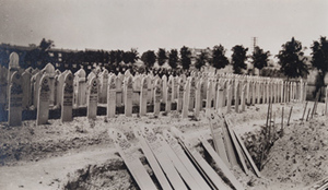 Rows of wooden boards marking graves of Algerian soldiers