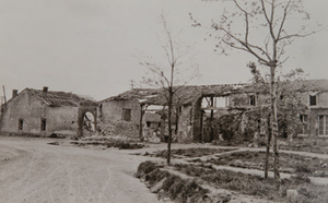 Street-level view of damage to village buildings