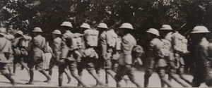 American soldiers marching along a tree-lined road