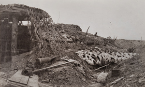 Exterior view of a camouflaged bunker and debris, outside Fort Douaumont