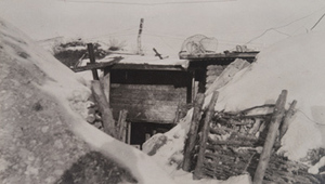A German dugout under barbed wire and snow