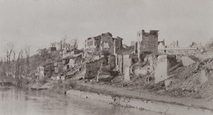 Badly damaged buildings along a river bank, Varennes-en-Argonne