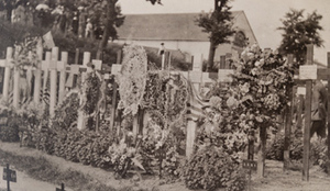 Close-up view of crowded rows of crosses decorated with flowers, marking graves of American soldiers, military cemetery, Châlons , 1919