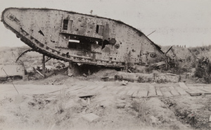 An overturned tank next to a plank road, Menin Road, between Ypres and Menen