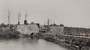 View of road and damaged town gate into Ypres