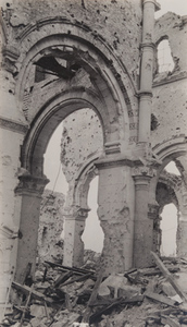 Close-up view of the remnants of a gothic arch from a destroyed stone building, Ypres, 1919